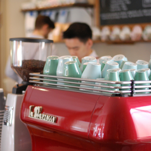Cafe Partnerships a barista serving coffee