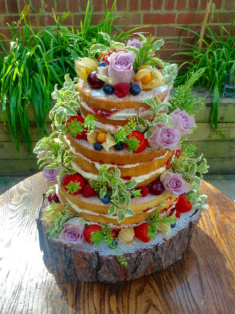 Three tiered summer fruit and flowers naked wedding cake