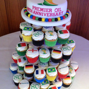 Corporate cake and iced cupcakes for 80th anniversary of Premier Oil