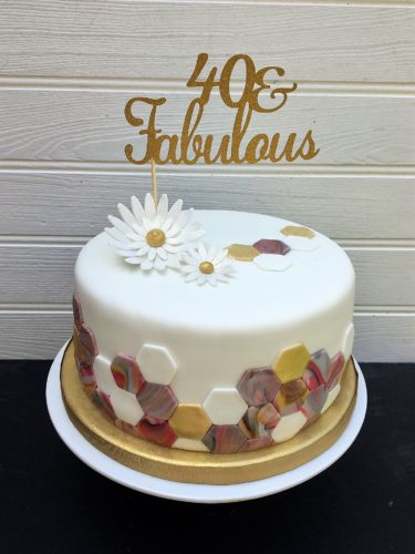 Geometric marbled birthday cake
