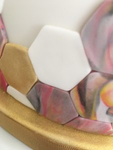 marbled and gold painted sugarpaste hexagons